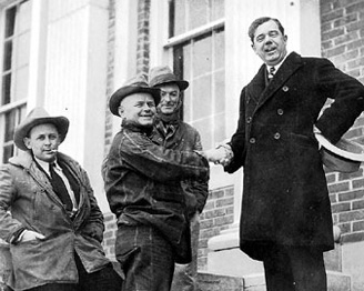 Huey Long shakes hands with rural farmers