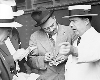 Huey Long speaks with reporters