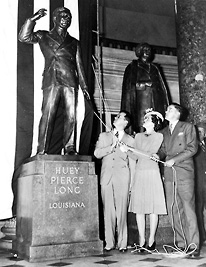 Huey Long's children, Russell, Rose and Palmer, unveil his statue in Statuary Hall of the U.S. Capitol.