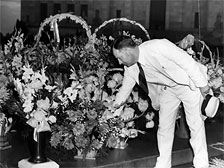 Huey's brother, Earl Long, lays flowers at Huey's gravesite on the Capitol grounds
