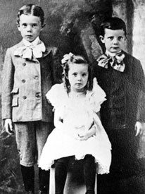 Huey Long as a child (left), with brother Earl and sister Lucille.