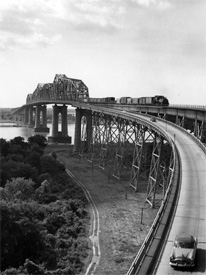 The massive Mississippi River bridge carrying rail and auto traffic.  The bridge was named after Huey P. Long following his assassination.