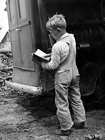 A child from Winn Parish, La., visits the bookmobile in 1938.  Books were rare in rural parishes until Huey Long's statewide initiatives to educate the rural poor.