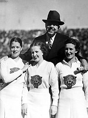 Huey Long with cheerleaders at a Louisiana State University football game.