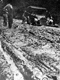 car stuck in the mud on a typical Louisiana road before Huey Long